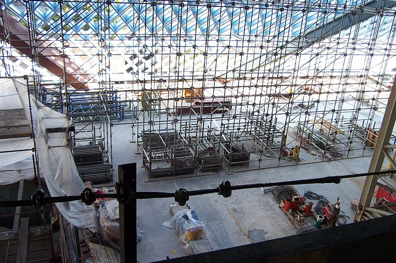 Straight down, this is the area between the top of the auditorium and the elevators on the third floor.  The new book shelves, the DVD collection, and the recorded books will go in this area.