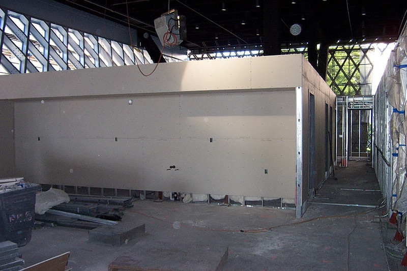 Looking down the hall toward our staff restrooms.  Our workroom sink, cabinets, and refrigerator will be installed on the tan wall at left.