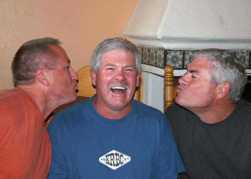 Dave and John giving Jim a kiss
