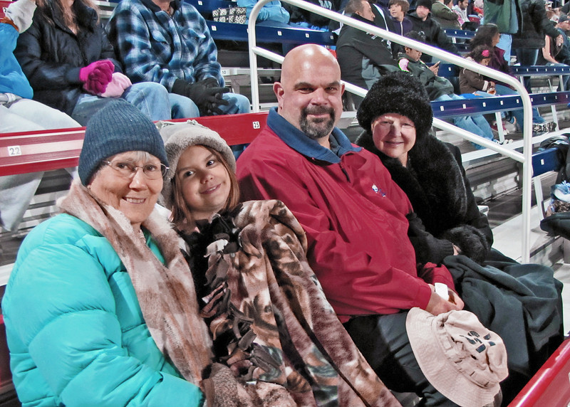A very cold night at the high school football game.  Susan, Astali, Craig and Sherry.