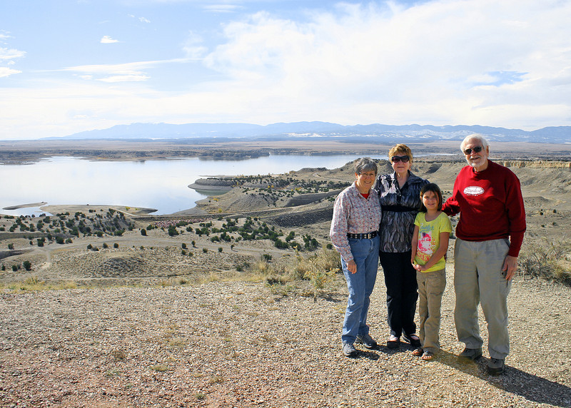 Liberty Point Recreation Center at Pueblo West, CO with Pueblo Reservoir in the background.  Susan, daughter Sherry, granddaughter Astali and Mike.