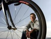 Cyclist Tyler Hamilton sits for a photo with his bike at his Boulder, Colo., home, Saturday, April 16, 2005. Hamilton was suspended Monday from competitive cycling for two years for a blood-doping violation discovered at a race in September. (AP Photo/Jack Dempsey)