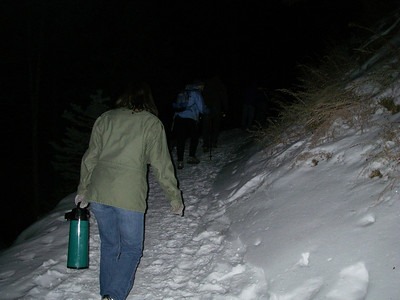 What am I doing here, following this person with a jug up some steep, moon-lit snowy trail?