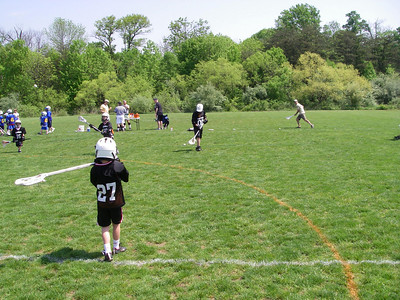 OK, Saturday morning at Zach's lacrosse game. That's him - #27.  [I missed Megan's earlier soccer game.]