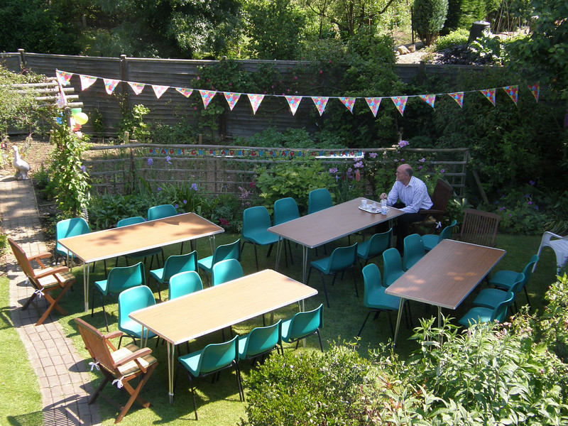 Henk sat with a cup of tea, waiting for the guests to turn up - Holy Trinity scout troop provided the tables and green chairs :-)