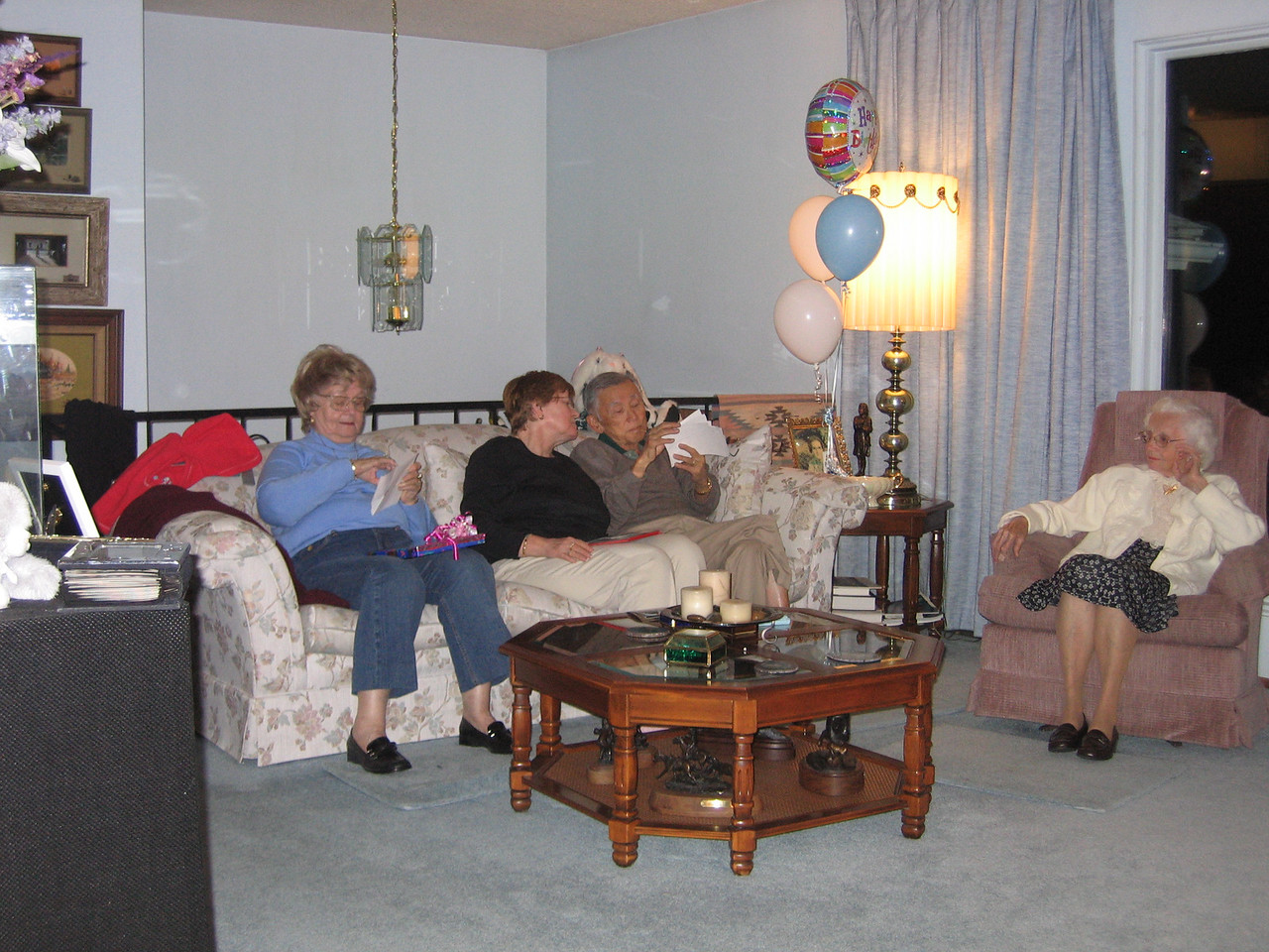 Grandma openning more presents and Mary Jo and Hank picking out pictures of Jesse and David.