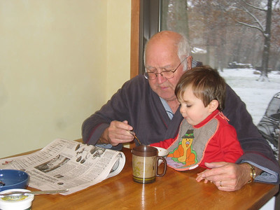 Lance helping Grandpa with breakfast.