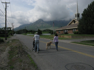 Off for an evening stroll. .. Ben Lomond behind the clouds. .. The iconic LDS church on right.