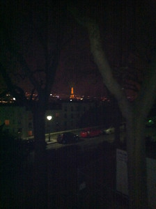 blurry Eiffel Tower in the distance
