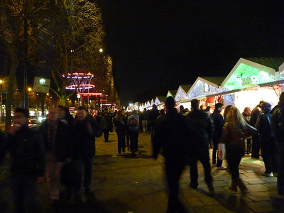 holiday craft booths and tons of people along the Champs Elysees. That night we had dinner at a bistro near the apt