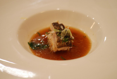 Madai in soy-kelp reduction, garnished with onion