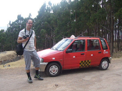 So we jumped into a taxi where the driver said he'd get us there in an hour. The most common taxis were these tiny Hyundai's. Dan always struggled to get into and out of them. On our drive up hills and out of Cusco, the taxi sputtered. The driver pulled over, opened the hood to check who knows what, went under the car to crank something. After a couple of failed starts, the driver SPIT into the engine.