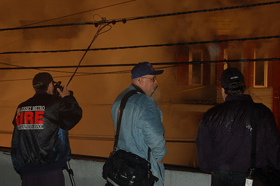 75, 64, and 73 shoot a Passaic job from the roof across the street.