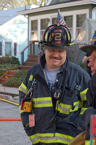 Maywood Firefighter and Chief of Police Dave Pegg happily works the pump on Engine 19 at a garage fire.