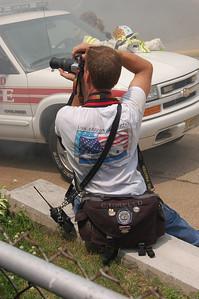Well equipped Chris Torello, Car 2105, shoots a Garfield fire.
