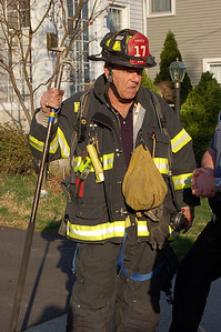 Maywood Firefighter Lou Turro takes a break at a garage fire.