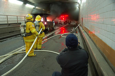 Car 1, Ed Gray shoots a drill in the Holland Tunnel.