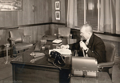 This is Cropped from original 8 x 10.  a label on the back of the photo says: Arthur E. Blackstone Chicago District Manager Dictaphone Corporation - in his private office  May 2 & 3 (sic) 1941.