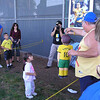 Kids taking a swipe at the Donovan pinata