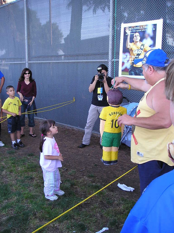 Kids taking a swipe at the Donovan pinata