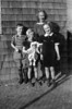 Henry II, Evelyn, Hazel, and Anita Oakes. Bay Shore, NY. Children of Henry and Melina Oakes. About 1941. What house is that in the background?