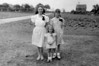Anita, Joann, and Evelyn Oakes. Bay Shore, NY. About 1946. Photo taken on the old Ghosio farm property where my Grandparents built their house (the house is not shown to the right). The cabbage patch behind the girls is where my father would build our house in the 1950s.
