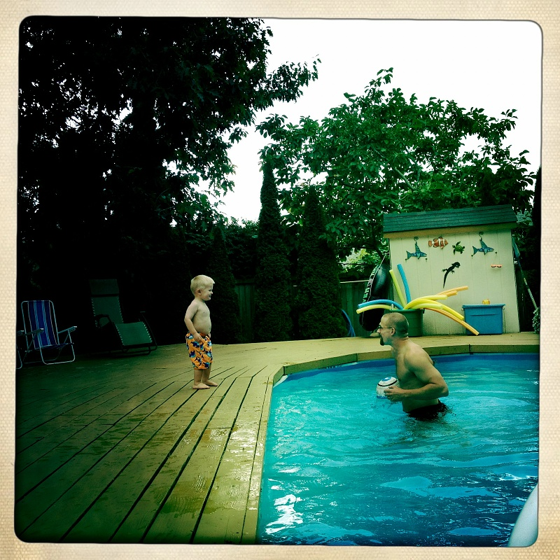 Trying to get Ethan in the pool.