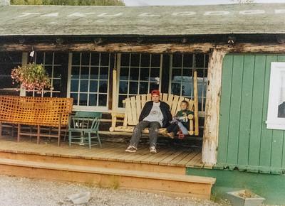 Ryan and Austin sitting on front porch of Taku Lodge