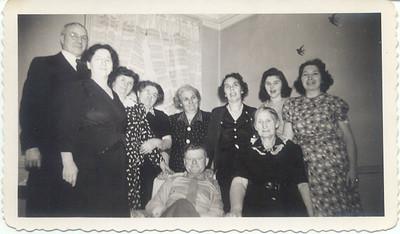 "1944: Jim Brennan, Sr, Margaret Henry Brennan, Lillian Henry Cuddy, Mary Henry Frost, Mamie Henry, Bessie Hampton Frost, Margaret ""Tiny"" Brennan, Peggy Henry, George Patrick Frost, Mrs. Gannon; 459 Lafayette, Brooklyn."