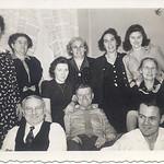 "1944: Lillian Henry Cuddy, Mary Henry Frost, Ann H, Gannon, Mamie Henry, Bessie Hampton Frost, Margaret ""Tiny"" Brennan, Gannon, Jim Brennan, Sr, George Patrick Frost, Jim Gannon; 459 Lafayette Ave."
