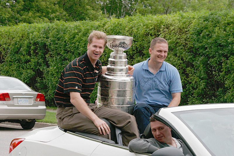 The Stanley Cup comes to Dryden thanks to Chris Pronger (dark shirt). <br /> <br /> He is neither a friend (although I've spoken to him) or family member but I had no where else to put the photo!<br /> <br /> This is the first time I've seen the Stanley Cup in person. I took some photos as they drove by me house.