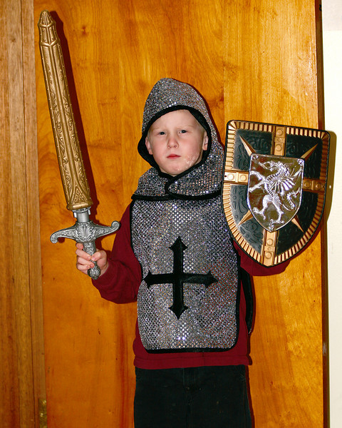 John is dressing up as a knight for Halloween this year.<br /> <br /> Here he is all dressed up in his costume to go to a Halloween dance at his school. And no, he didn't dance. He ran around the gym screaming like the rest of the kids.