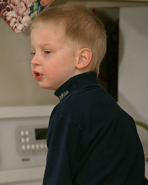 John in the kitchen waiting to help Mom bake some cookies for Santa.