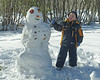 The end result.<br /> <br /> Too bad the weather turned warm, this snowman was pretty much gone two days later.