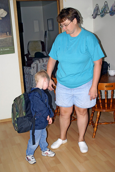 At first he was excited to get his picture taken before leaving for his first day at school, but then he changed his mind.