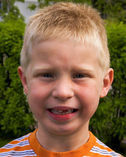 John lost another tooth! The tooth fairy left him a Loonie and a Toonie!<br /> <br /> (All I ever got was a quarter!)