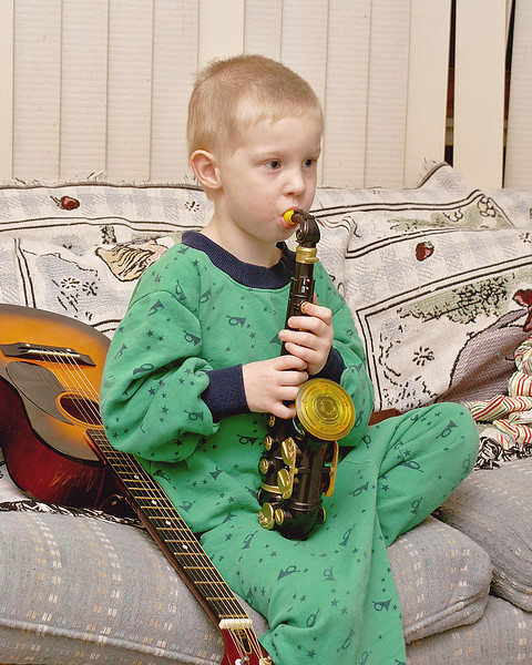 It was a musical instrument Christmas this year. Here he is with two of the instruments John received this year, the guitar and the Sax.
