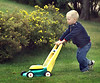 John thinks it's fun now to mow the lawn, but little does he know that it will become his job!<br /> <br /> Shot through a window.