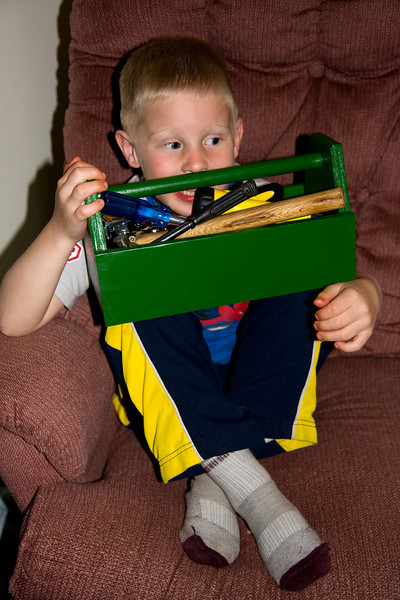 John was pretty happy with the little toolbox I built for him out of scrap plywood. He was even happier about the ral tools I put in it (new screwdrivers, and 'stubby' crescent wrenches).<br /> <br /> Of course he wouldn't show much emotion when I showed him the new toolbox, I had to see that later. He appears to be hiding a smile behind the tools.<br /> <br /> It didn't turn out too badly considering all I had for cutting the wood was a compound miter saw. I hope he takes care of it, if so it should last for a long time.
