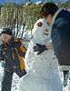 Mom and John work on the first snowman on the season