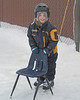 Just getting ready to start skating. He uses the chair until he learns some balance. This is behind the school in the basketball court - some of the teachers flooded it so everyone could skate.