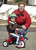 John and Wendy. John was getting frusterated due to the rocks on the road, making it harder for him to ride his new tricycle.