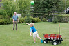 John and Grandpa Ed playing ball in the backyard.