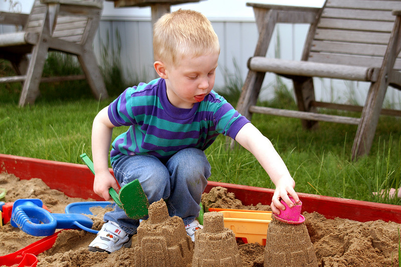 Adding another level to his sand castle.<br /> <br /> I added a sandbox to the backyard for him to play in. Basically a sheet of plywood, with 2x8's for sides, and another sheet of plywood for the top to keep the animals and weather out of the sand.