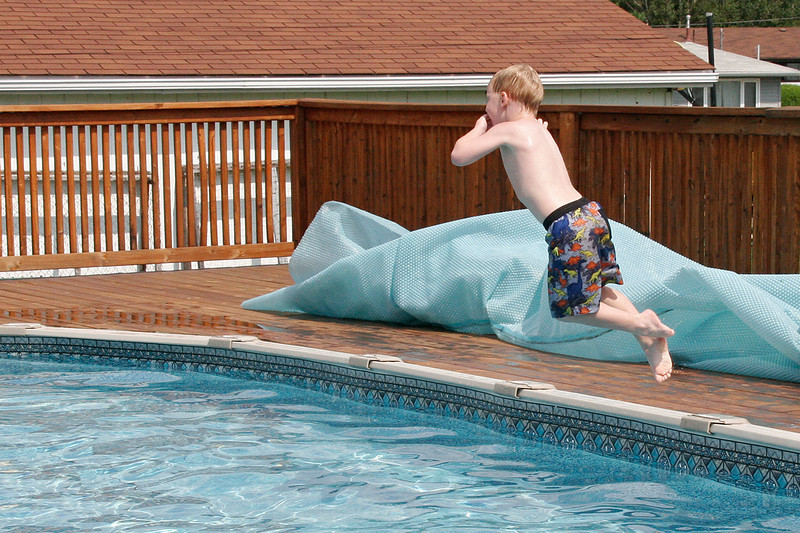 John is getting pretty brave. Here he is jumping into the pool - without his lifejacket or water wings.