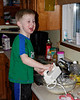 John loves to bake. Here he is mixing up some cup cake batter.