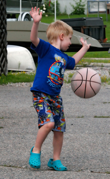 Ok, I'm not sure what he is doing here - but he was playing basketball.
