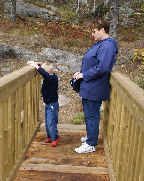 On another bridge at Rushing River. John had fun throwing rocks into the water.
