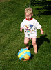 He is getting really good at kicking a ball.