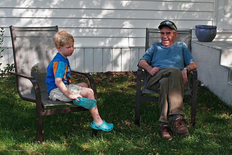 John and Grandpa Ed discussing world issues.